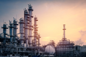 Manufacturing of petroleum industrial plant with sunset sky background, Gas distillation tower in petrochemical plant