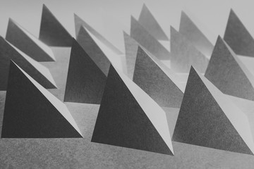 Pyramidal shapes of paper, composition for abstract background