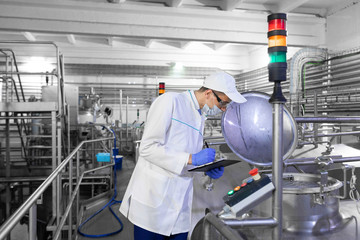 technologist controls the production of dairy products At the plant