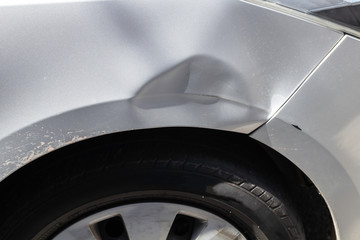 Car accident marks at the rear wheel fender.