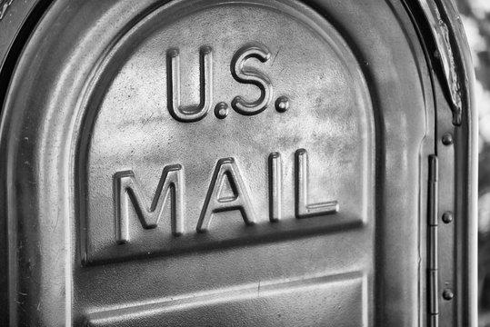 US Mail written on a mailbox