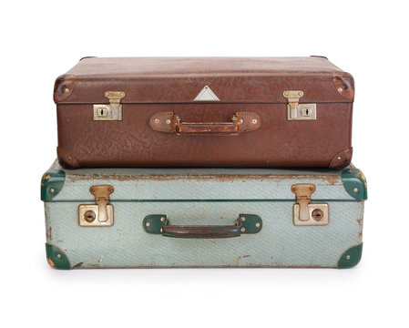 Two old vintage suitcases on white background, contains clipping path
