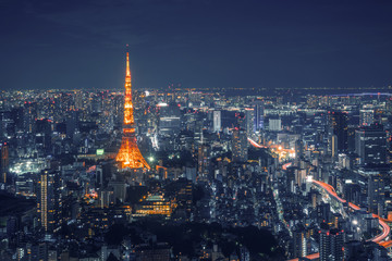 Tokyo Skyline and view of skyscrapers on the observation deck at night time in Japan.