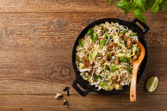 Fried veal, with rice, Chinese cabbage and mushrooms. Sprinkled with sesame and soy sauce.