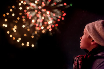 Rear view of a boy watching a firework display