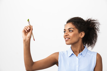 Beautiful young african woman atrist holding a paint brush