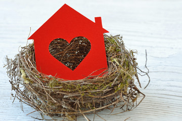 House paper with heart in nest - Love for home concept