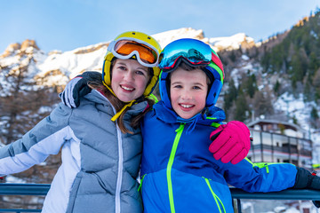 Portrait of little skiers laughing