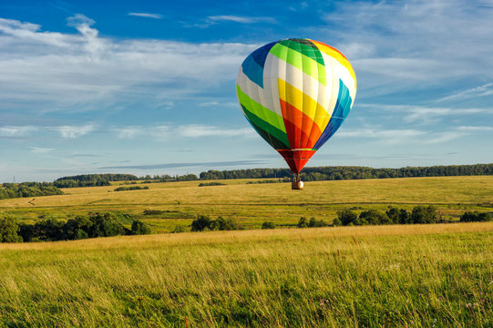 Many colorfull balloons in the sky at blue sky with clouds background