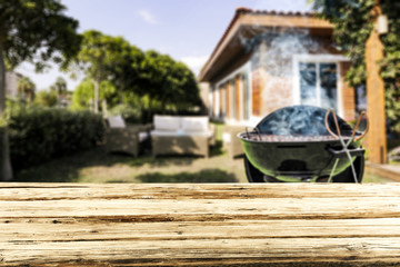 Table background and grill in garden