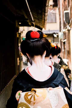 Maiko (apprentice geishas) observe Hassaku, in Gion area of Kyoto