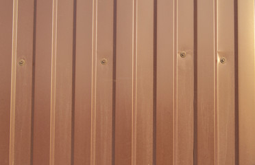 Brown metal siding, modern finishing material for the manufacture of fences and exterior wall cladding