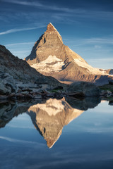 Matterhorn and reflection on the water surface during sunrise. Beautiful natural landscape in the Switzerland. Matterhorn, Zermatt, Switzerland-Image