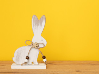 sweet easter bunny figure yellow background