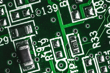 Green electronics technology background. Detailed circuit board texture.