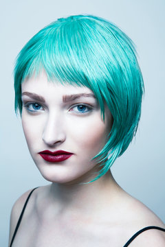 Portrait of young woman with blue hair