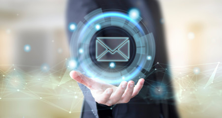 businessman with digital mail icon