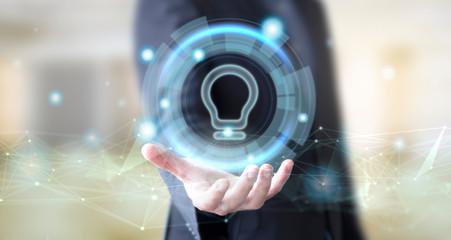 businessman with digital lightbulb icon