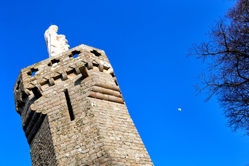 Tower and white statue on Mont Dol in Brittany, France.