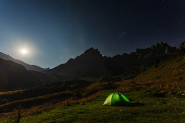Evening, night and morning camping tents in France with beautiful views of the Alpine Mountains.