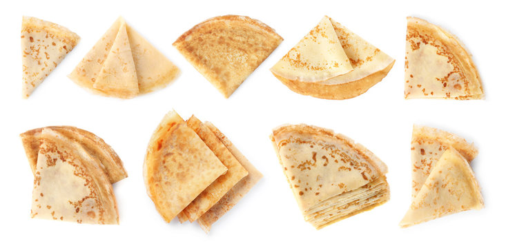 Set of folded tasty thin pancakes on white background, top view