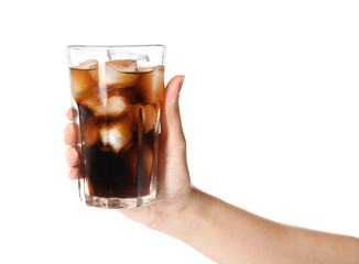 Woman holding glass of refreshing cola with ice on white background, closeup