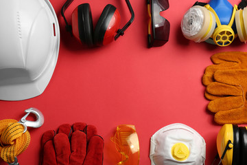 Flat lay composition with safety equipment and space for text on color background