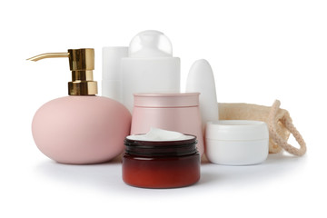 Different body care products and wisp on white background