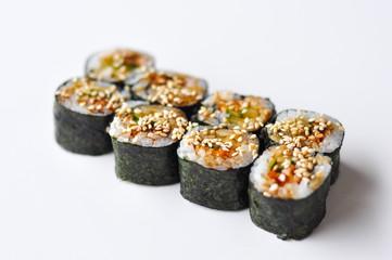 Fototapeta Unagi maki rolls with eel and cucumber on white background obraz