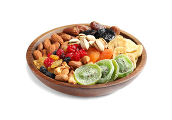 Bowl with different dried fruits and nuts on white background