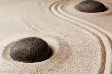 Foto op Plexiglas Stenen in het Zand Zen garden stones on sand with pattern. Meditation and harmony