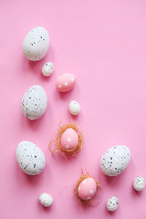Set of colored eggs on a pink background. Festive Easter concept.