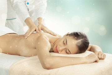 Beautiful young woman relaxing with massage at beauty spa