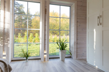 Bright photo studio interior with big window, high ceiling, white wooden floor Wall mural