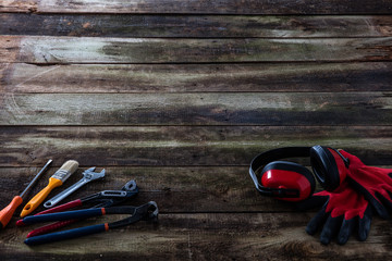 DIY job, building or maintenance tools over vintage wooden background