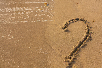Half of Heart on the Sand in the Beach.