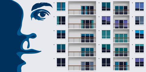 Street art avec une peinture murale représentant un portrait géant sur un mur d'immeuble de banlieue