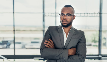 Portrait of a confident black businessman holding with his arms crossed