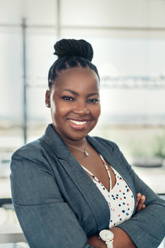 Portrait of a beautiful smiling black businesswoman with her arms crossed