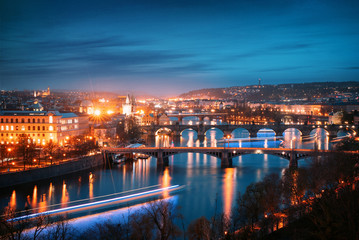 Prague cityscape at night. Aerial view of the bridges on the Vltava river