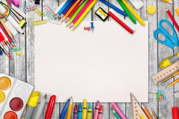 Colorful school supplies on wooden table background Wall mural