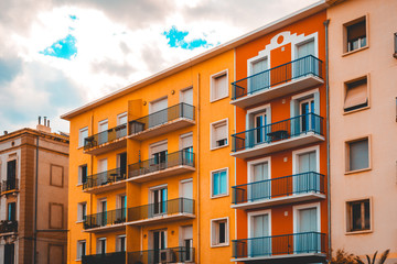 orange and red colored apartment houses at france