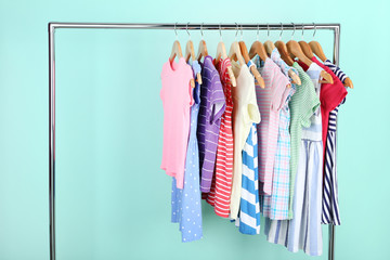 Clothes hanging on mint background