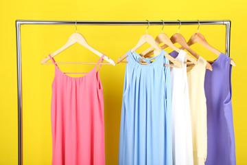 Fashion dresses hanging on wooden hanger