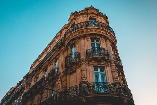 historical corner building with ancient orange facade