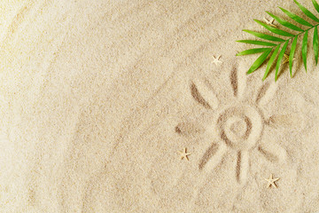 Tropical background. Palm tree branche with starfish on sandy background. Travel.