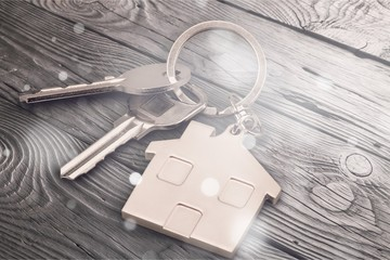 House keys with house figure  on background