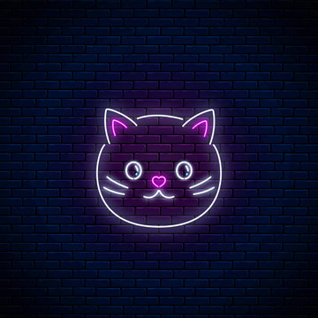 Glowing neon sign of cute cat in kawaii style. Cartoon happy smiling kitty in neon style.