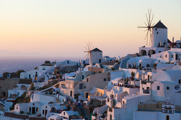 View of Oia Village with windmills at sunset, Santorin, Greece