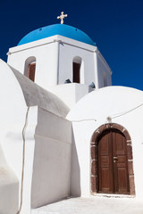 Houses and architecture in white and blue on Santorin Greece